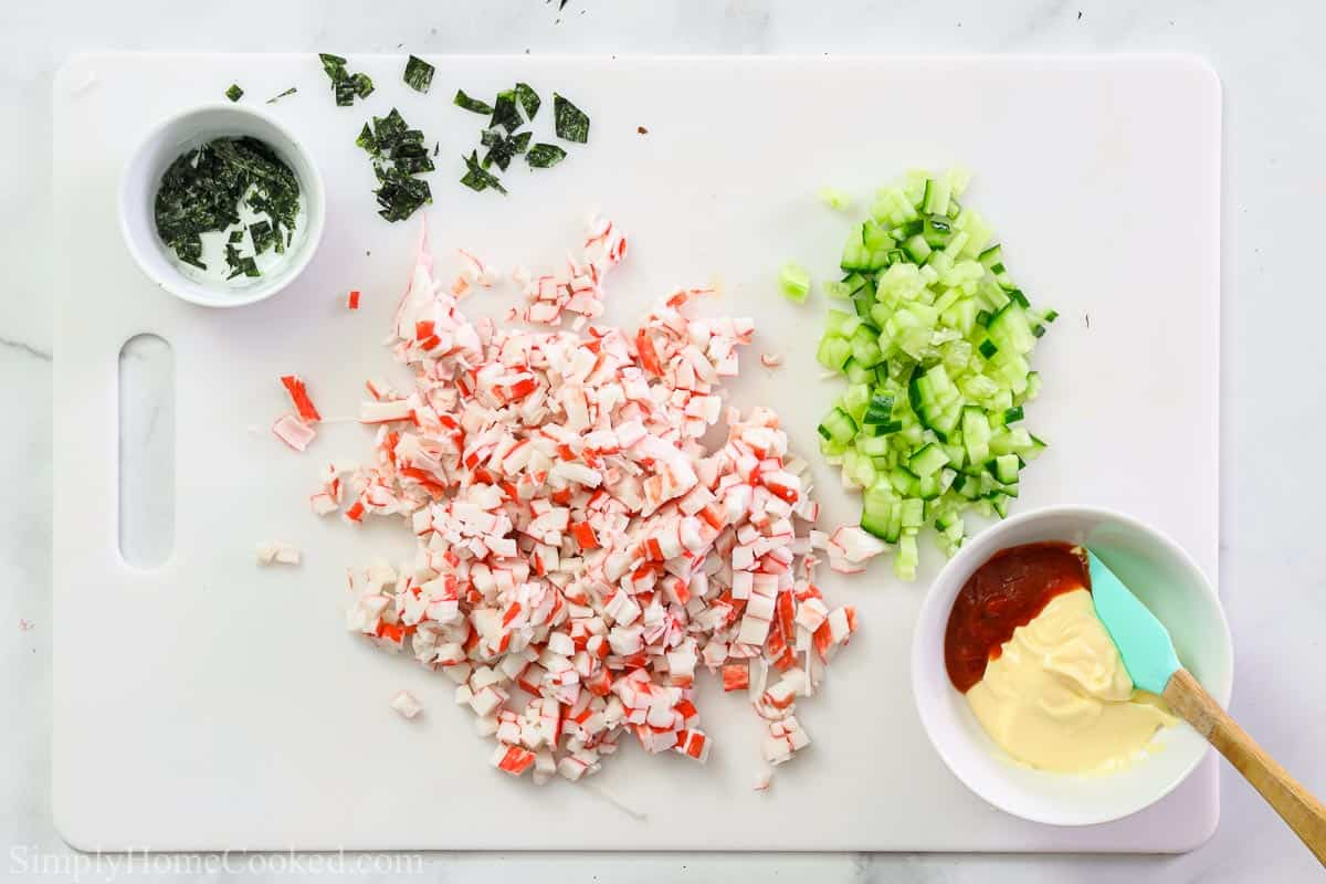 Steps to make California Sushi Bowls, including chopping the crab meat and cucumber, crumbling the nori sheets, and then making the spicy mayonnaise.