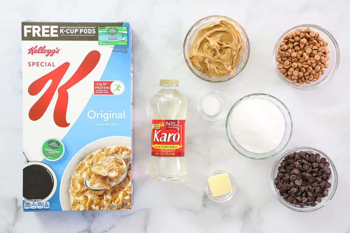 Ingredients for Chewy Special K bars, including Special K cereal, peanut butter, butterscotch chips, chocolate chips, corn syrup, butter, granulated sugar, and coarse sea salt.