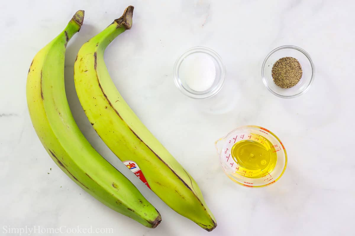 Ingredients for Baked Plantain Chips, including green plantains, salt, pepper, and oil.