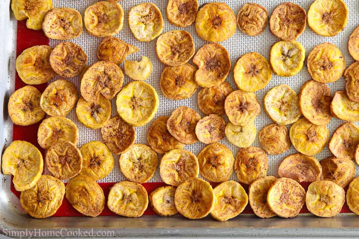 Close up of Baked Plantain Chips on a baking sheet pan.