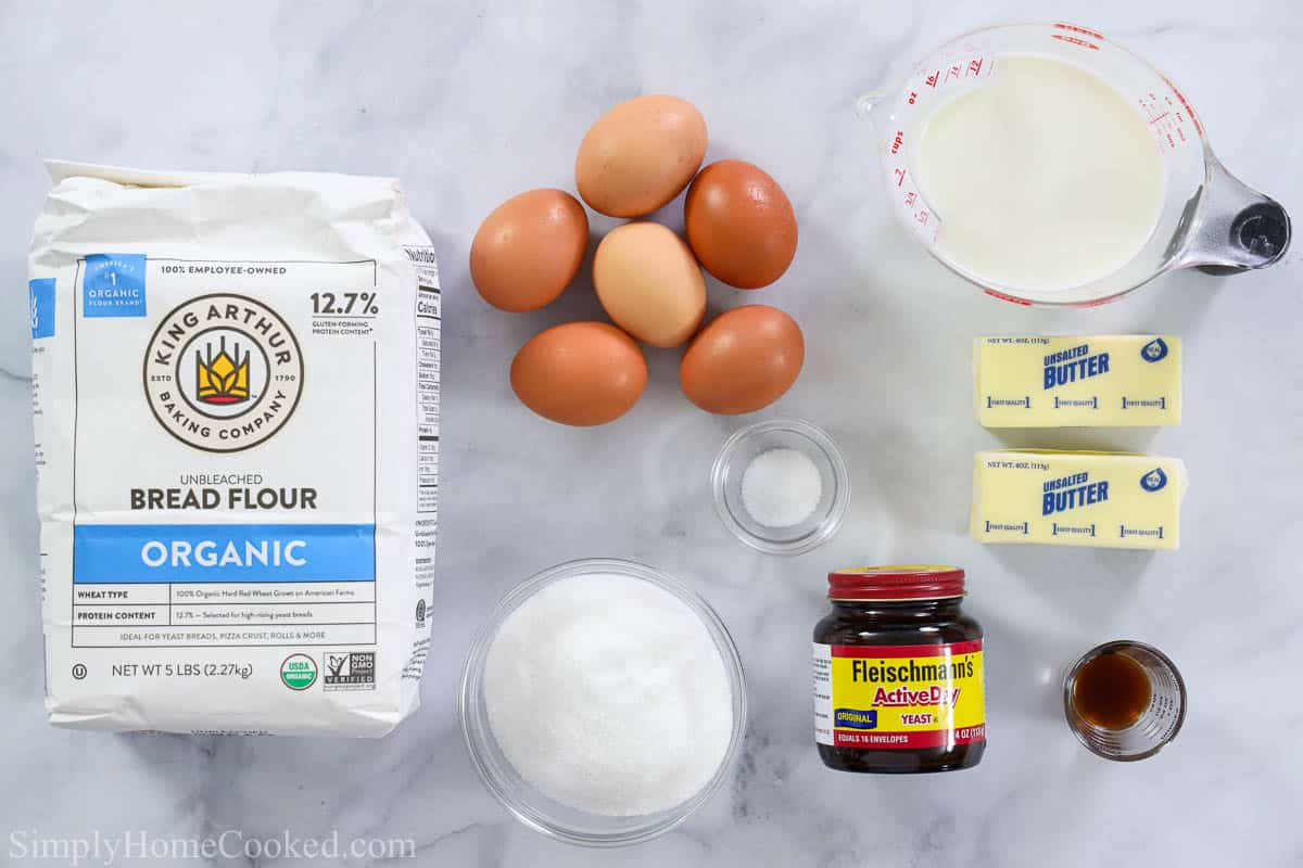 Ingredients for Buttery Brioche Bread, including bread flour, eggs, salt, milk, yeast, vanilla, butter, and sugar.
