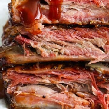 Vertical image of stacked Smoked Ribs