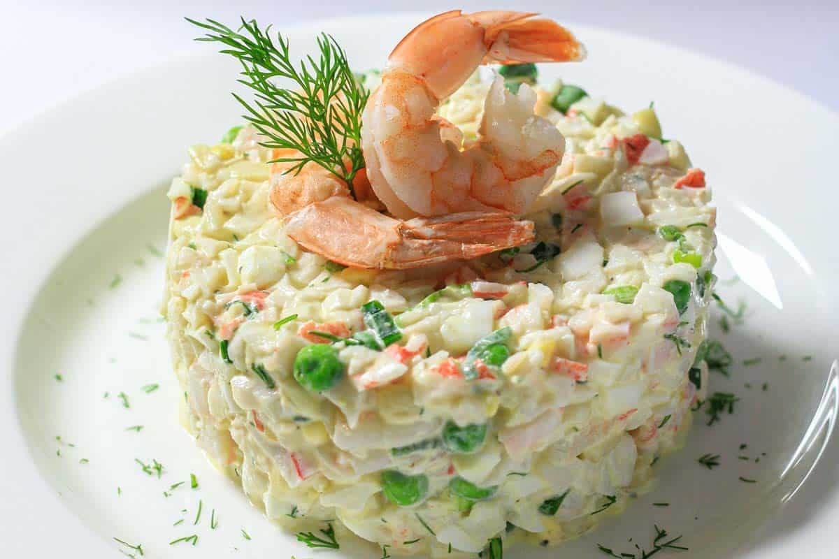 Crab Salad molded and topped with shrimp and dill